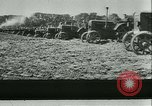 Image of tractors and plows France, 1942, second 16 stock footage video 65675020604