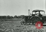 Image of tractors and plows France, 1942, second 23 stock footage video 65675020604