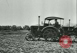 Image of tractors and plows France, 1942, second 24 stock footage video 65675020604