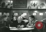 Image of men in bar Germany, 1941, second 54 stock footage video 65675020685
