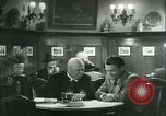 Image of men in bar Germany, 1941, second 61 stock footage video 65675020685