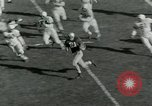 Image of Football match Lawrence Kansas USA, 1950, second 14 stock footage video 65675020705