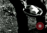 Image of Marmite can rations in Korean War Korea, 1951, second 58 stock footage video 65675020780