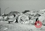 Image of brick cleaning Berlin Germany, 1955, second 25 stock footage video 65675020796