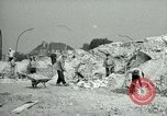 Image of brick cleaning Berlin Germany, 1955, second 26 stock footage video 65675020796
