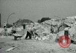 Image of brick cleaning Berlin Germany, 1955, second 31 stock footage video 65675020796