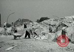 Image of brick cleaning Berlin Germany, 1955, second 34 stock footage video 65675020796