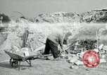 Image of brick cleaning Berlin Germany, 1955, second 39 stock footage video 65675020796