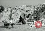 Image of brick cleaning Berlin Germany, 1955, second 40 stock footage video 65675020796
