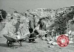 Image of brick cleaning Berlin Germany, 1955, second 41 stock footage video 65675020796