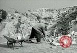 Image of brick cleaning Berlin Germany, 1955, second 42 stock footage video 65675020796