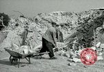 Image of brick cleaning Berlin Germany, 1955, second 43 stock footage video 65675020796