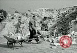 Image of brick cleaning Berlin Germany, 1955, second 44 stock footage video 65675020796