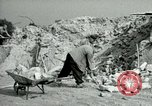 Image of brick cleaning Berlin Germany, 1955, second 45 stock footage video 65675020796