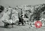 Image of brick cleaning Berlin Germany, 1955, second 46 stock footage video 65675020796