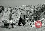 Image of brick cleaning Berlin Germany, 1955, second 47 stock footage video 65675020796