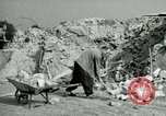 Image of brick cleaning Berlin Germany, 1955, second 48 stock footage video 65675020796