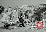 Image of brick cleaning Berlin Germany, 1955, second 49 stock footage video 65675020796