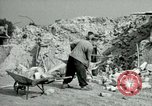 Image of brick cleaning Berlin Germany, 1955, second 50 stock footage video 65675020796