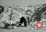 Image of brick cleaning Berlin Germany, 1955, second 51 stock footage video 65675020796