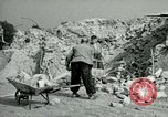 Image of brick cleaning Berlin Germany, 1955, second 52 stock footage video 65675020796