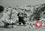 Image of brick cleaning Berlin Germany, 1955, second 53 stock footage video 65675020796