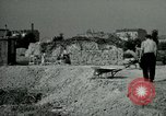Image of brick cleaning Berlin Germany, 1955, second 55 stock footage video 65675020796
