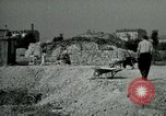 Image of brick cleaning Berlin Germany, 1955, second 56 stock footage video 65675020796