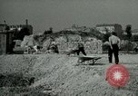 Image of brick cleaning Berlin Germany, 1955, second 58 stock footage video 65675020796