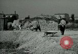 Image of brick cleaning Berlin Germany, 1955, second 59 stock footage video 65675020796