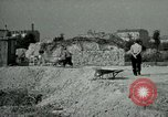 Image of brick cleaning Berlin Germany, 1955, second 60 stock footage video 65675020796