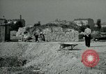 Image of brick cleaning Berlin Germany, 1955, second 61 stock footage video 65675020796