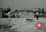 Image of brick cleaning Berlin Germany, 1955, second 62 stock footage video 65675020796