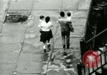Image of Puerto Rican immigrants go to church and play baseball Bronx New York City USA, 1965, second 34 stock footage video 65675020826