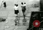 Image of Puerto Rican immigrants go to church and play baseball Bronx New York City USA, 1965, second 37 stock footage video 65675020826