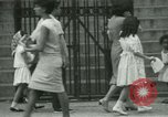 Image of Puerto Rican immigrants go to church and play baseball Bronx New York City USA, 1965, second 42 stock footage video 65675020826