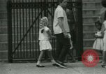 Image of Puerto Rican immigrants go to church and play baseball Bronx New York City USA, 1965, second 43 stock footage video 65675020826