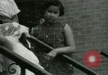 Image of Puerto Rican immigrants go to church and play baseball Bronx New York City USA, 1965, second 52 stock footage video 65675020826