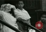 Image of Puerto Rican immigrants go to church and play baseball Bronx New York City USA, 1965, second 53 stock footage video 65675020826
