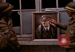 Image of Hitler portrait Cherbourg Normandy France, 1944, second 14 stock footage video 65675020905