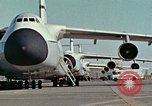 Image of  F-5E Tiger II fighters being loaded on C-5 transport aircraft California United States USA, 1976, second 4 stock footage video 65675021081