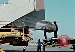 Image of  F-5E Tiger II fighters being loaded on C-5 transport aircraft California United States USA, 1976, second 15 stock footage video 65675021081