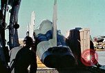 Image of  F-5E Tiger II fighters being loaded on C-5 transport aircraft California United States USA, 1976, second 17 stock footage video 65675021081