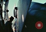 Image of  F-5E Tiger II fighters being loaded on C-5 transport aircraft California United States USA, 1976, second 21 stock footage video 65675021081
