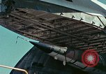 Image of  F-5E Tiger II fighters being loaded on C-5 transport aircraft California United States USA, 1976, second 26 stock footage video 65675021081