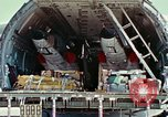 Image of  F-5E Tiger II fighters being loaded on C-5 transport aircraft California United States USA, 1976, second 30 stock footage video 65675021081