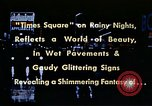 Image of Times Square neon lights New York City USA, 1954, second 15 stock footage video 65675021109