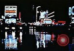 Image of Times Square neon lights New York City USA, 1954, second 30 stock footage video 65675021109