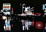 Image of Times Square neon lights New York City USA, 1954, second 37 stock footage video 65675021109