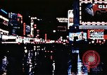 Image of Times Square neon lights New York City USA, 1954, second 41 stock footage video 65675021109
